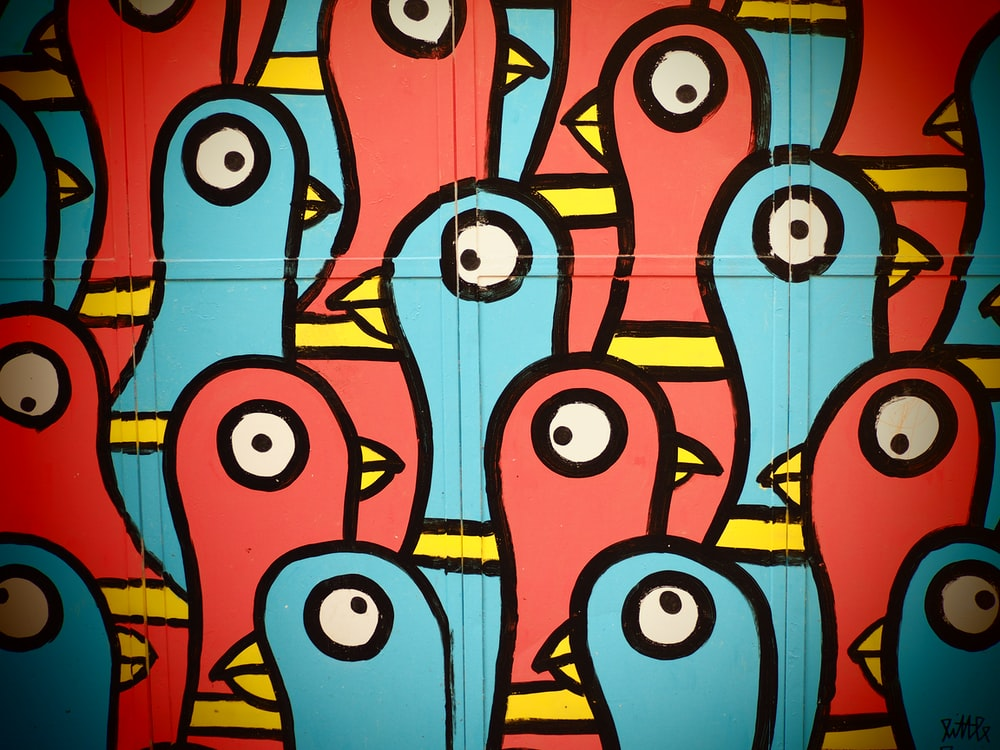 blue and multicolored bird abstract art