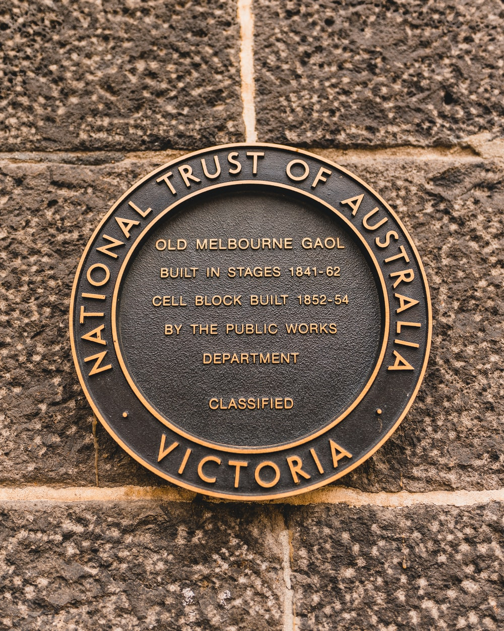 round brown and black National Trust of Australia Victoria coin