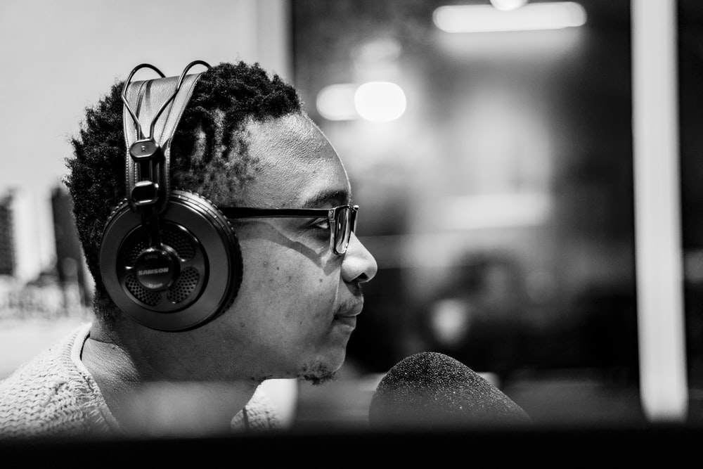 grayscale photography of man wearing headphones