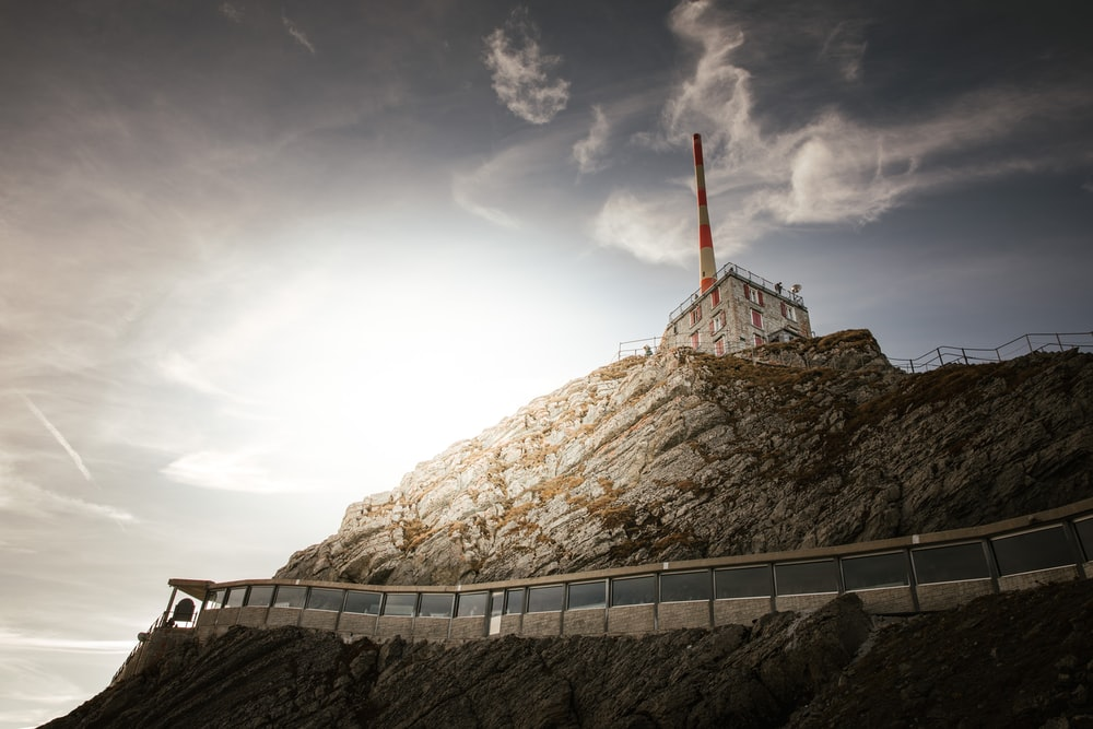 concrete building on top of rock formation