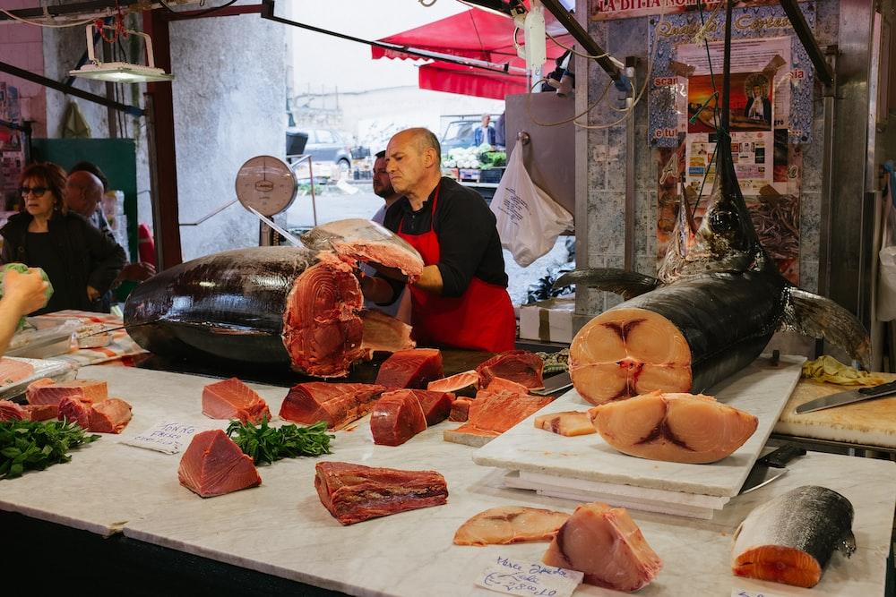 man slicing fish