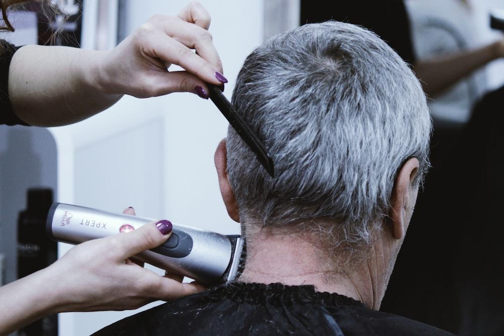 woman taking haircut
