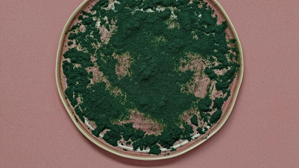 green powder on round pink lid