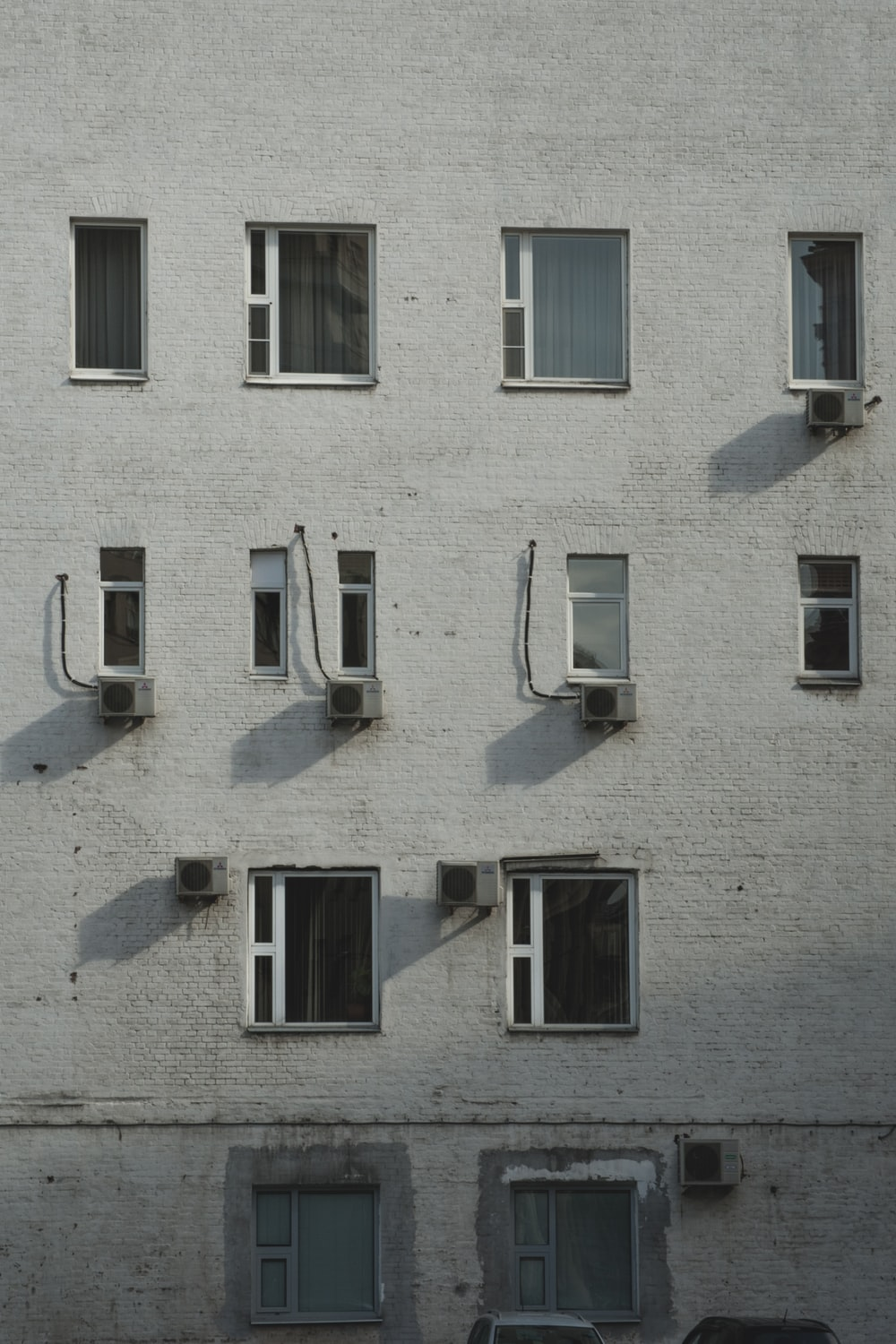 white concrete building with window open