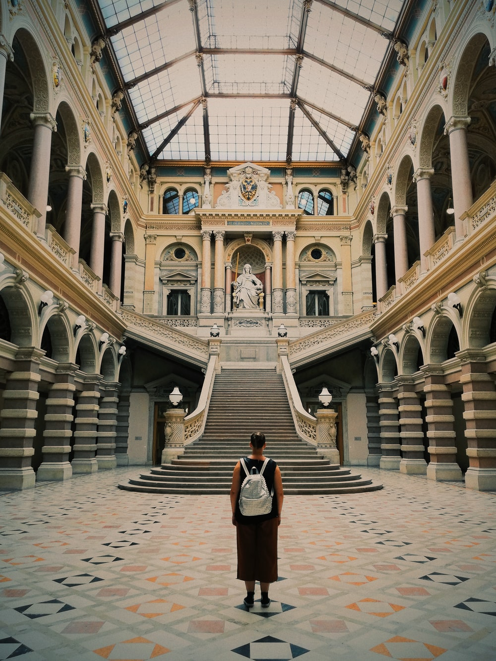 person standing inside Palace of Justice, Vienna