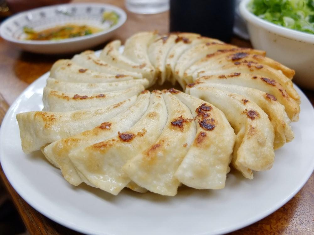 sliced pancake on round white ceramic plate