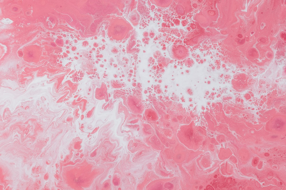 pink and white fluid abstract painting