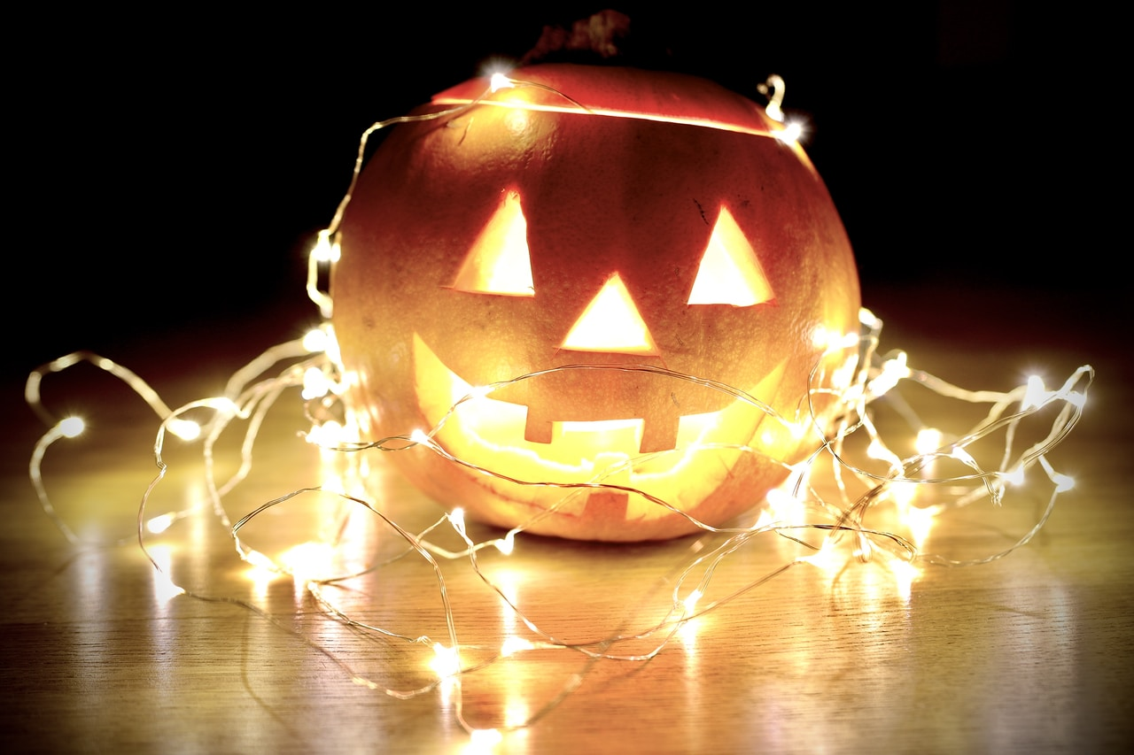 lighted string lights wrapped on Jack-O'-Lantern