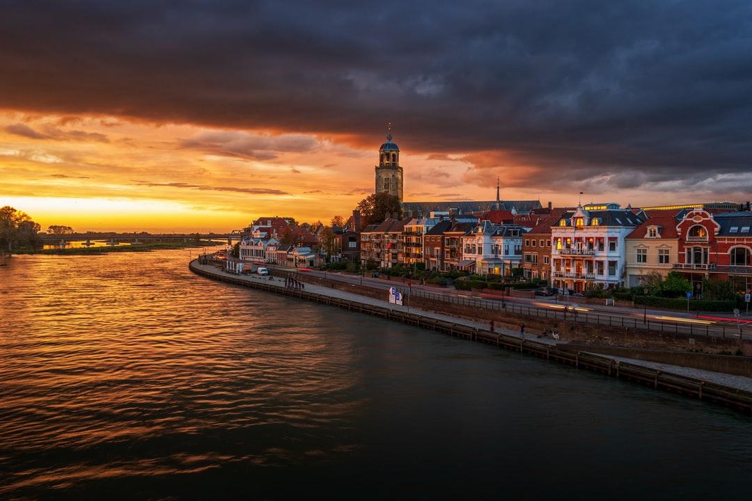 Beautiful sunset over the river IJssel with sunlight on the tower of Deventer.