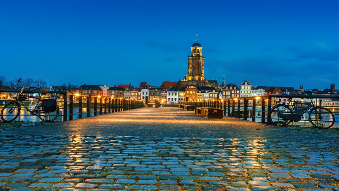 Bluehour image of the Cityscape of Deventer with reflections in cobblestone.