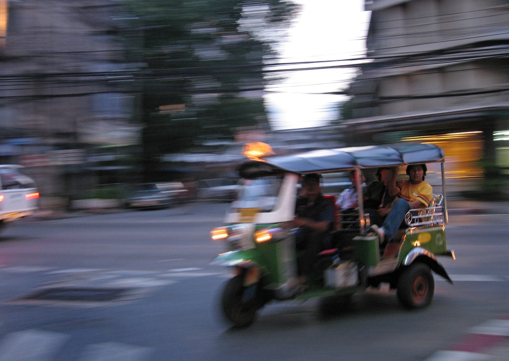 people riding on auto rickshaw