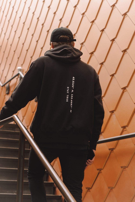 man in black hoodie on staircase