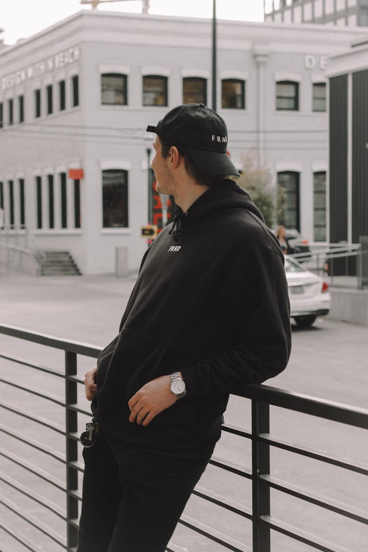 man wearing black jacket and