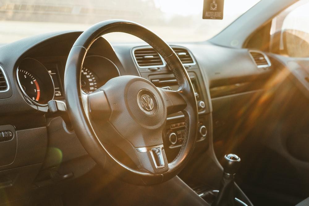 sunlight piercing through Volkswagen steering wheel