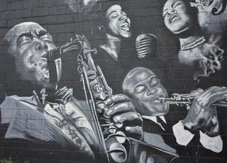 grayscale photo of men playing musical instruments