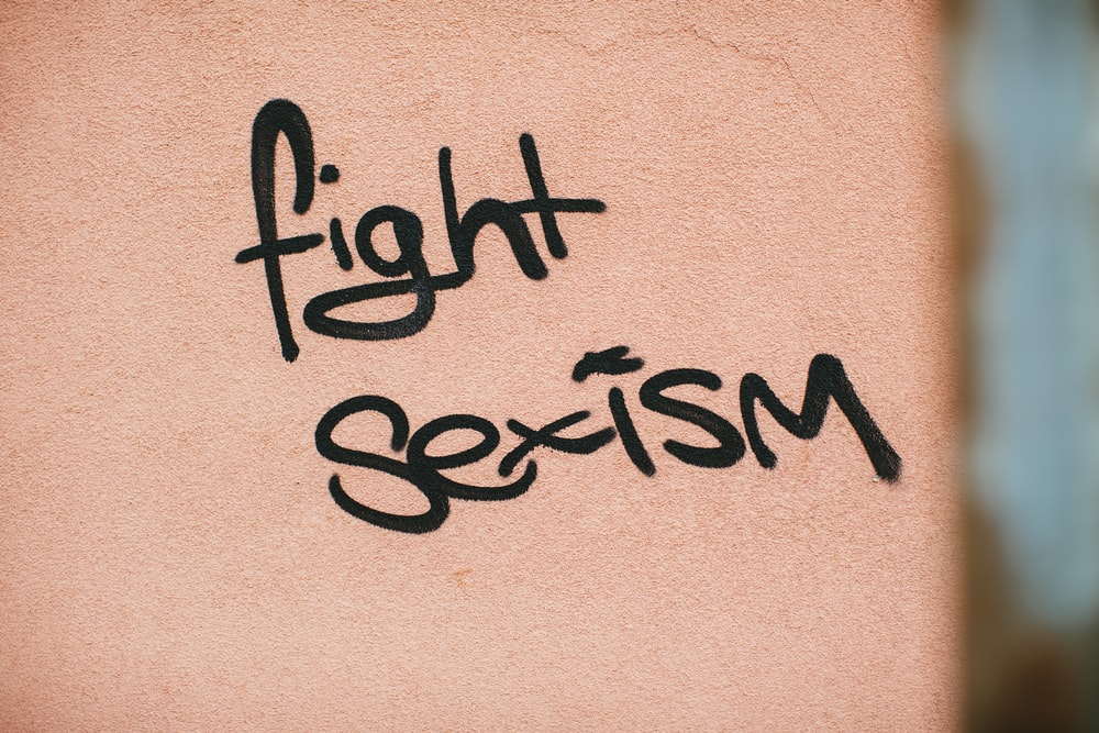 black fight sexism text