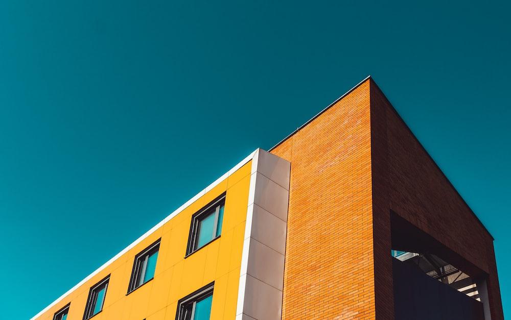 orange concrete building low angle photography