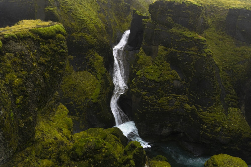 waterfall and rocky cliff with moss