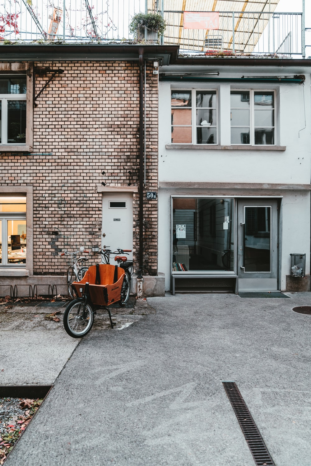 bicycle with seat parked in front of bricked building