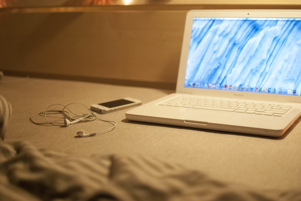 white MacBook on grey table