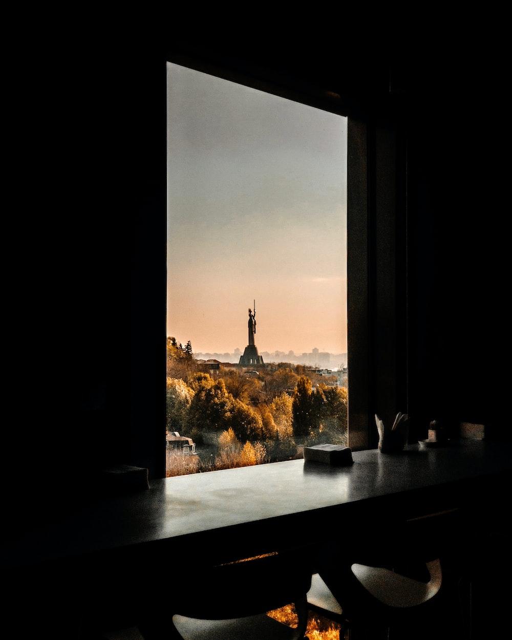 black wooden table near window panel