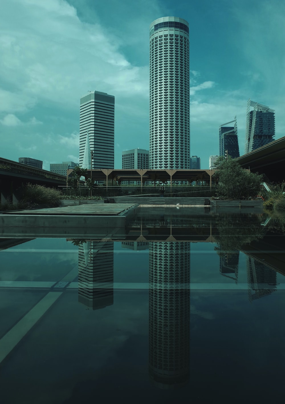 reflection of high rise buildings on mirror floor