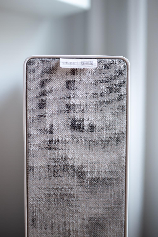 gray and white portable speaker