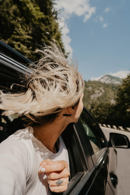 woman riding black vehicle