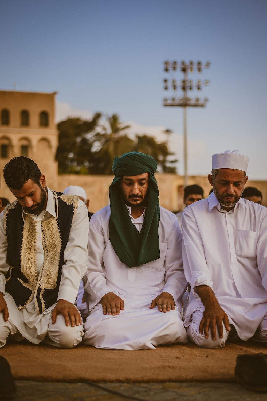 men sitting on brown carpet
