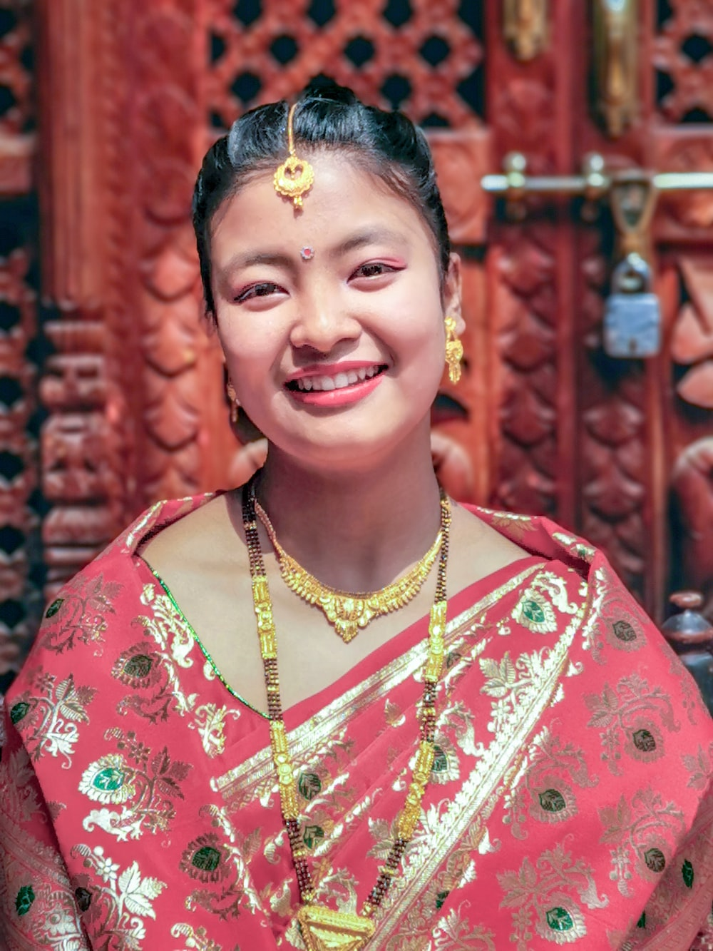 woman wears pink sari dress
