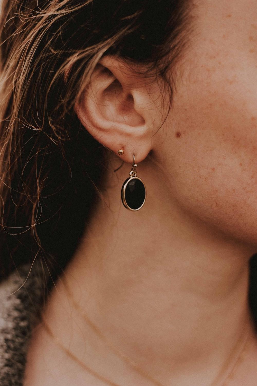 woman wearing silver-colored earrings