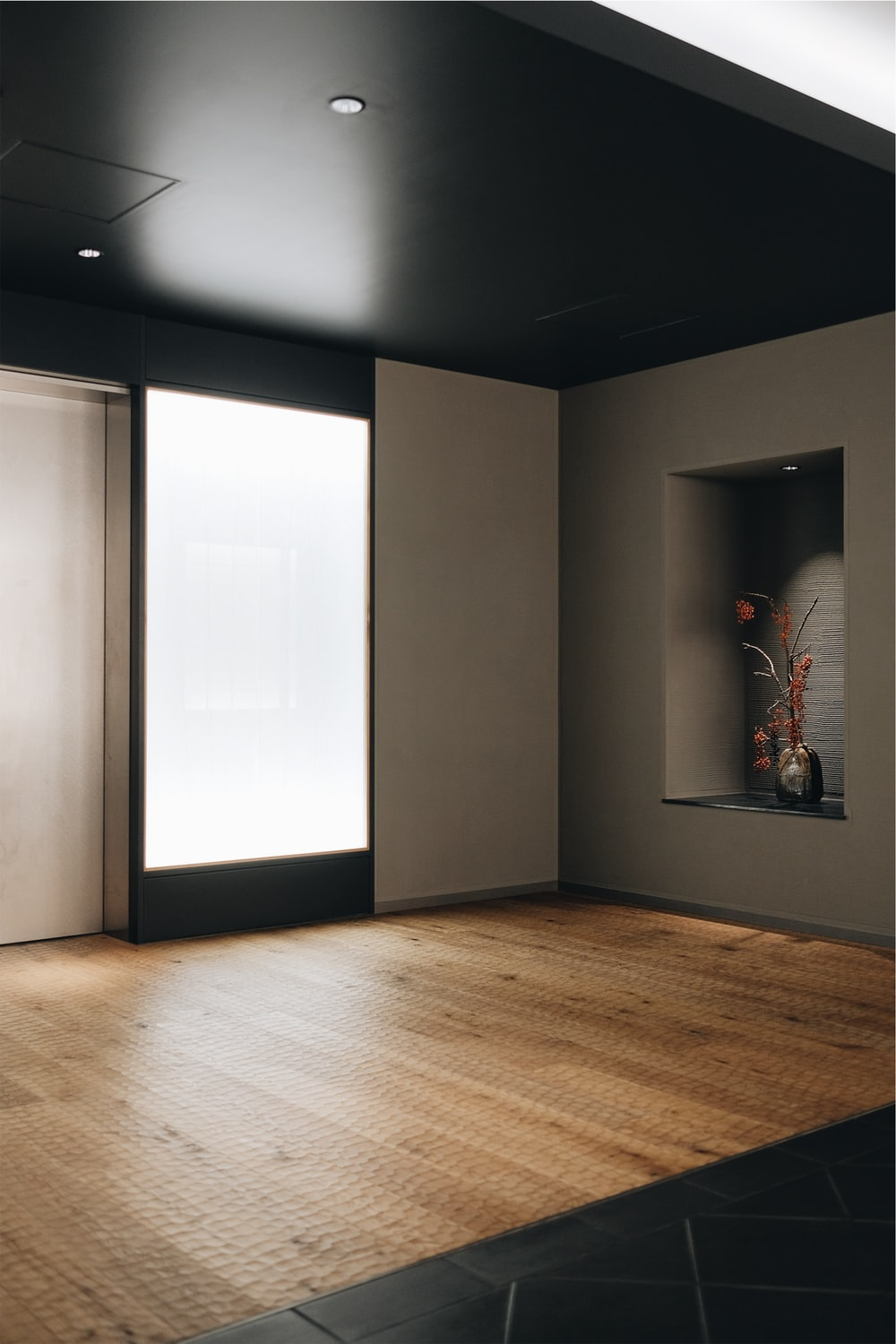 brown wooden floor and white walls
