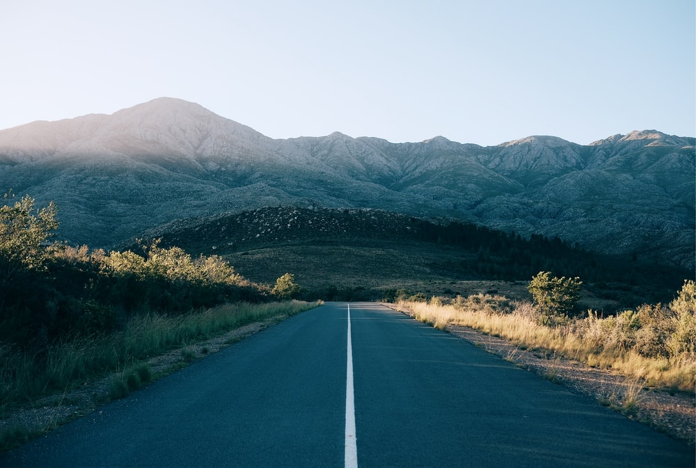 concrete road leading to the mountains