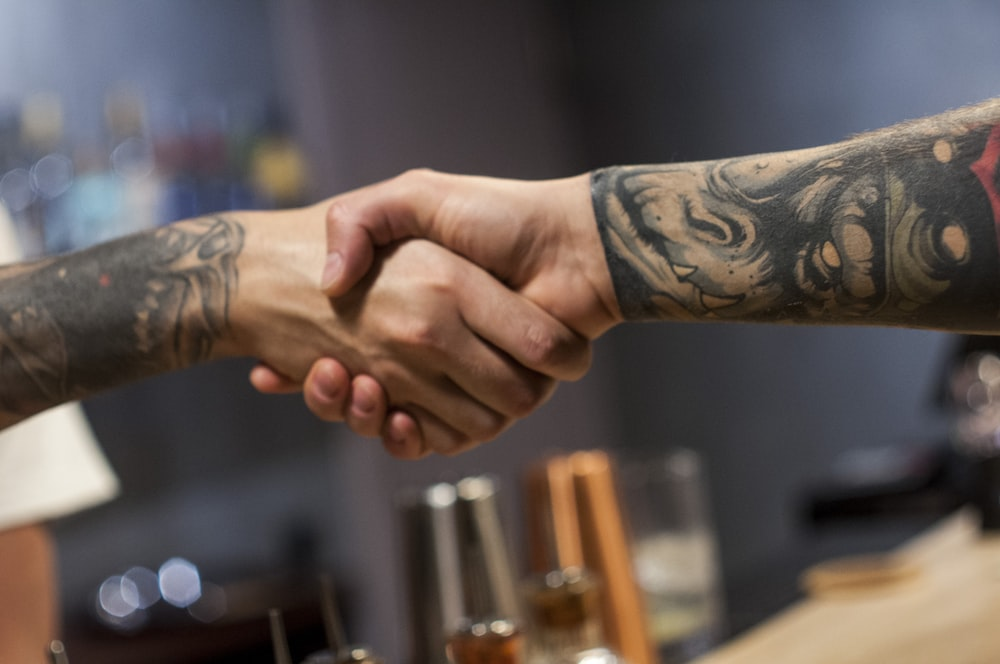 two person shake hands photograph
