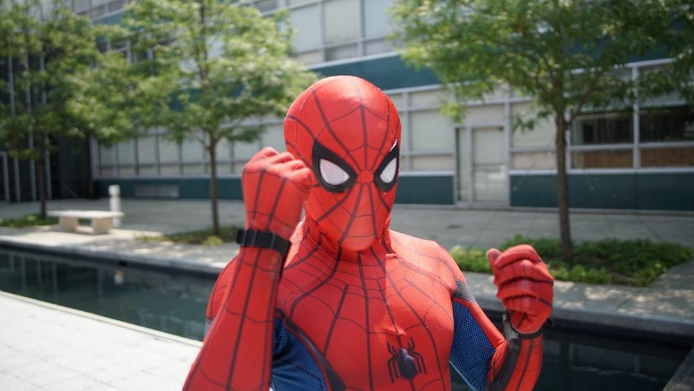 Spider-Man near white building