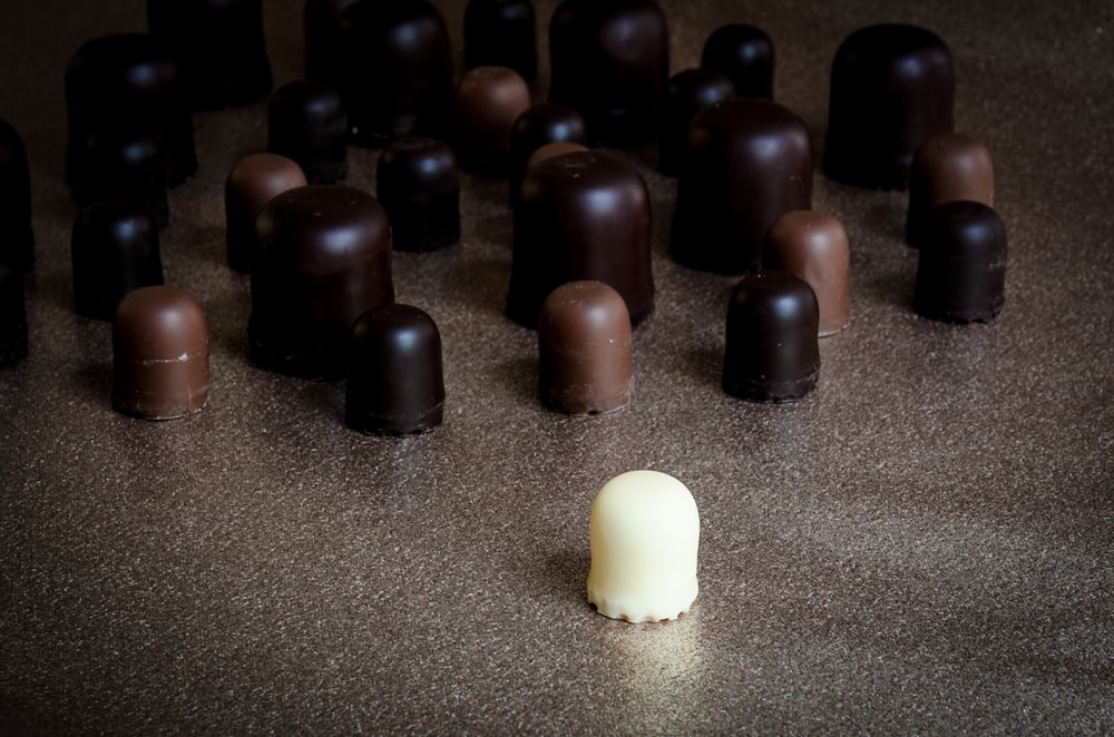 milk chocolate in front of scattered chocolates