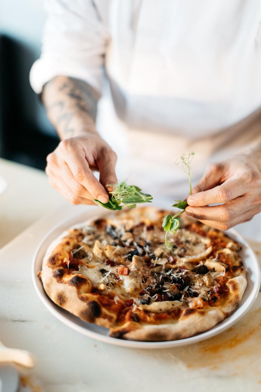 person preparing pizza