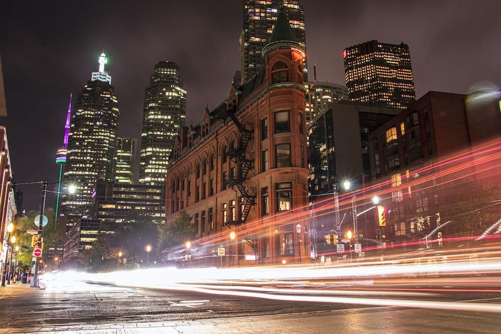 light streaks photography of vehicle lights on road