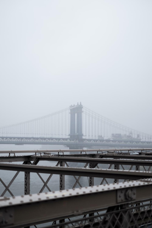 cable bridge under white sky
