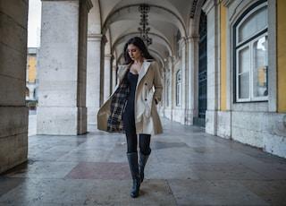 woman in a coat at a hallway