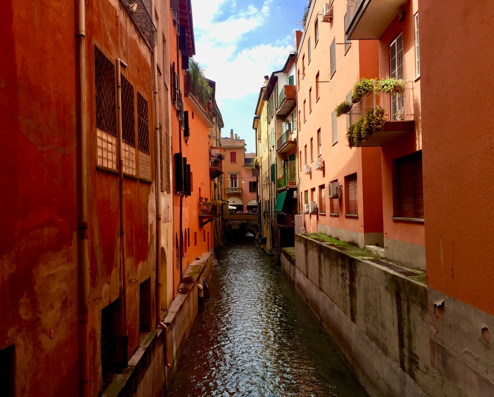 canal lined by orange buildings