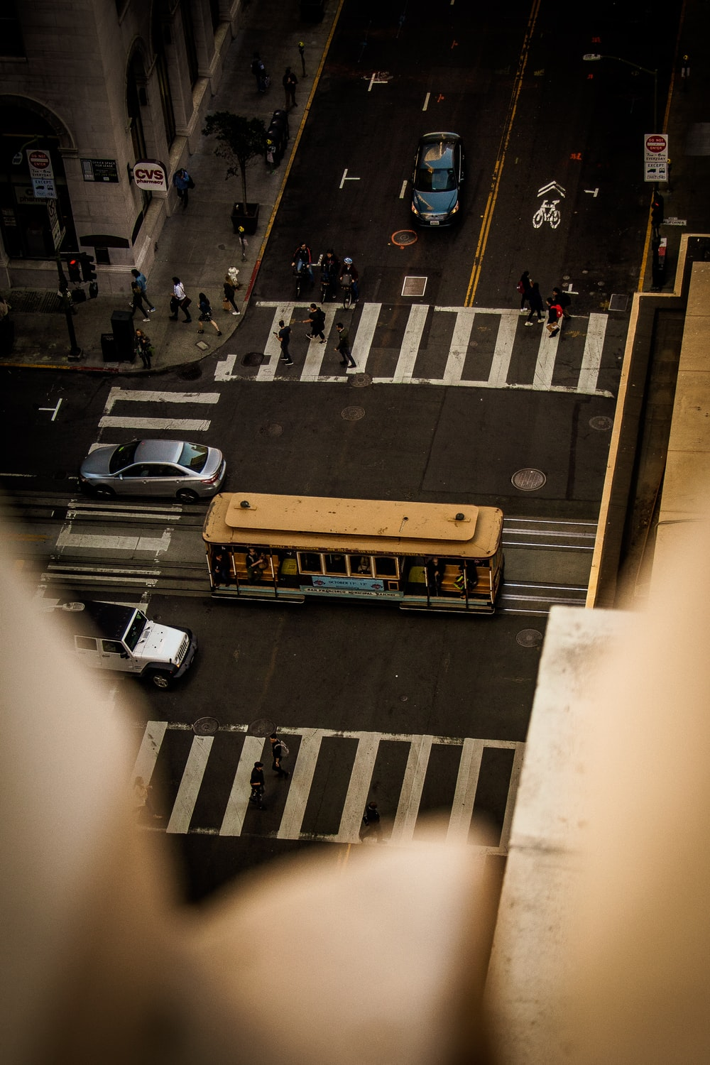 yellow bus on paved road
