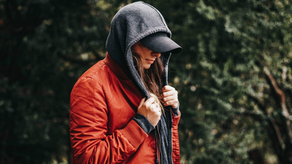 woman wearing red and grey jacket