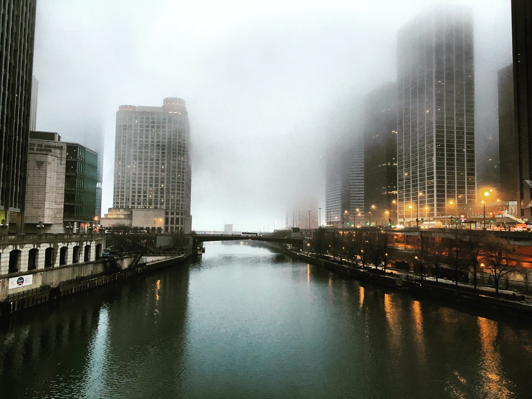 Cold morning in the city of winds in Chicago, where the buildings merge with the cloudy sky.