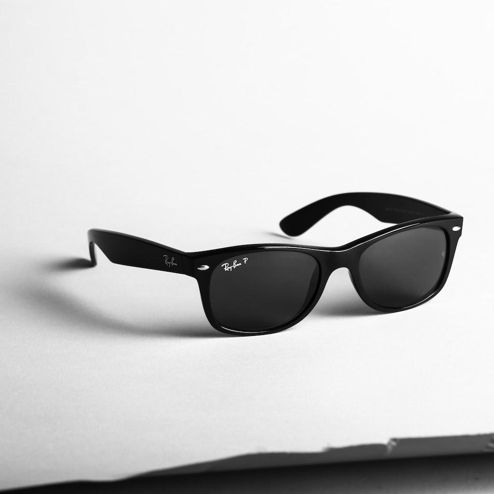 shallow focus photo of black Ray-Ban wayfarer sunglasses
