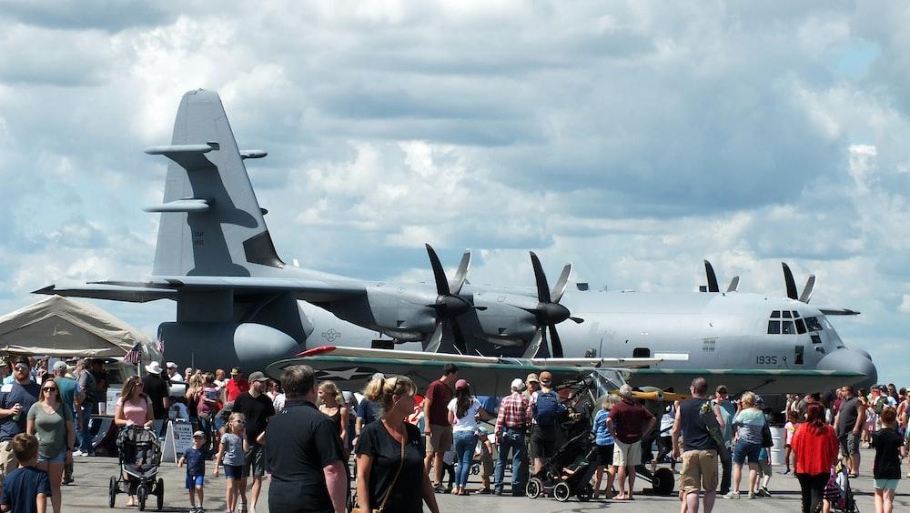 people standing beside airliner