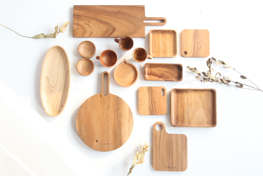 top view of assorted shape and sized wooden kitchen utensils