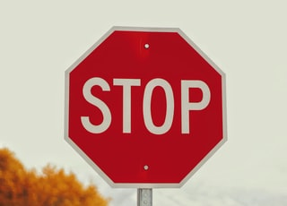selective-photography of stop signage