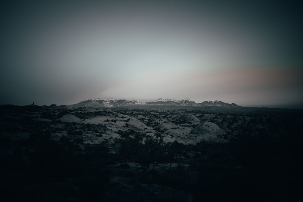 grayscale photography of mountain covered with snow