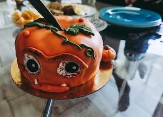 orange covered cake on table